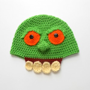 Slimer Crochet Hat - If you're looking for something to wear for your children this Halloween, these 13 spooky crochet hat patterns for kids is a start. #kidscrochethat #crochethatpatterns #spookycrochethat
