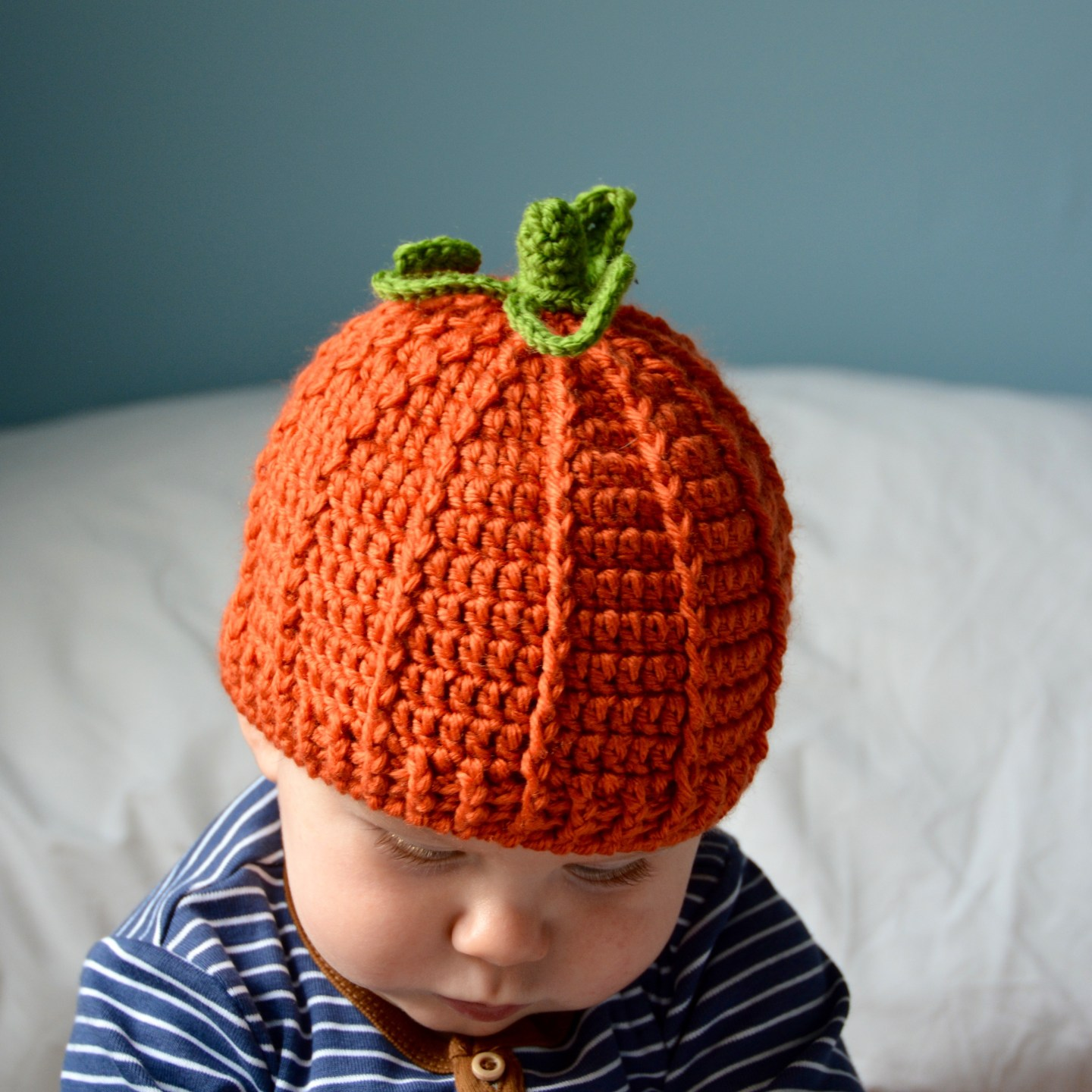 The Pumpkin Beanie Hat - If you're looking for something to wear for your children this Halloween, these 13 spooky crochet hat patterns for kids is a start. #kidscrochethat #crochethatpatterns #spookycrochethat