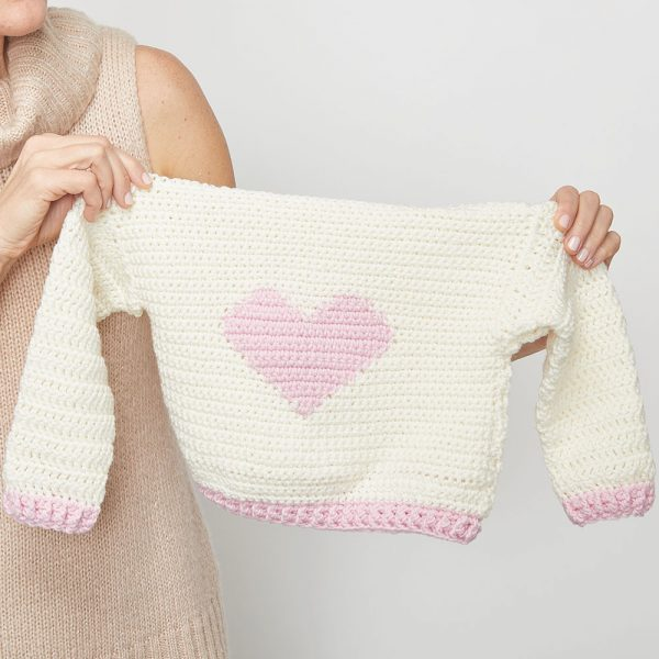 Children's Heart Sweater - These crochet sweaters make for amazing gifts, that will surely be well used, and well worn. #CrochetSweaterPatterns #CrochetSweater #CrochetPatterns