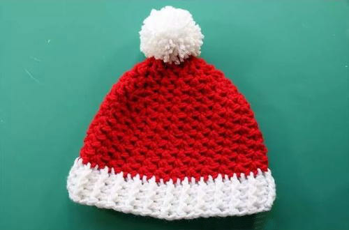 Child Crochet Santa Hat - This list of Christmas Crochet hat patterns will supply you with anything from the classics (Santa, Rudolph, Snowman) to fun animals and well-loved characters. #ChristmasCrochetHatPatterns #CrochetHatPatterns #CrochetPatterns