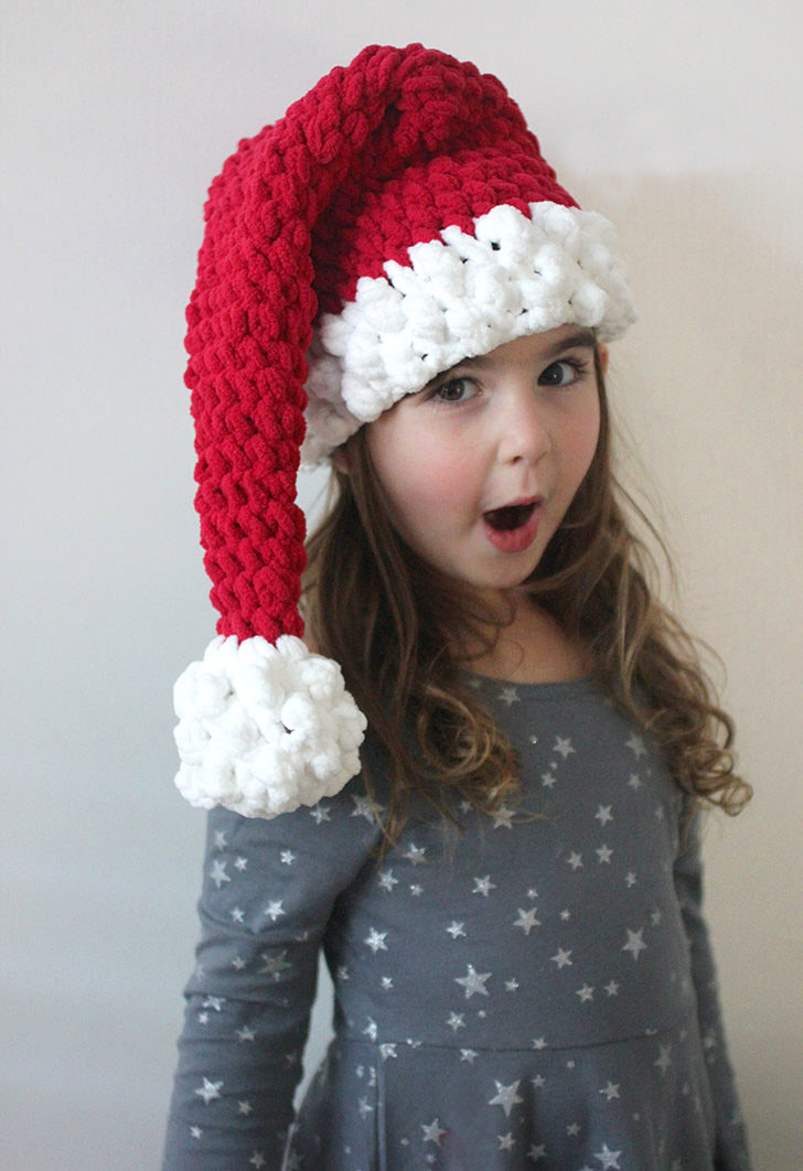 Crochet Santa Hat - This list of Christmas Crochet hat patterns will supply you with anything from the classics (Santa, Rudolph, Snowman) to fun animals and well-loved characters. #ChristmasCrochetHatPatterns #CrochetHatPatterns #CrochetPatterns