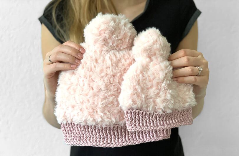 Fluffy Winter Hat - This list of Christmas Crochet hat patterns will supply you with anything from the classics (Santa, Rudolph, Snowman) to fun animals and well-loved characters. #ChristmasCrochetHatPatterns #CrochetHatPatterns #CrochetPatterns