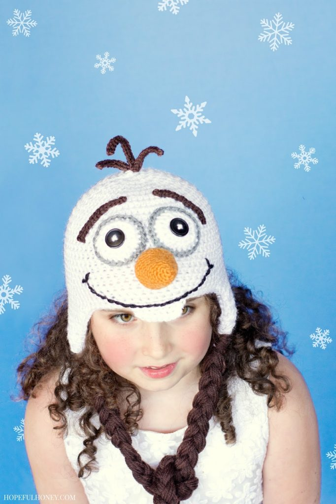 Frozen Olaf Inspired Hat - This list of Christmas Crochet hat patterns will supply you with anything from the classics (Santa, Rudolph, Snowman) to fun animals and well-loved characters. #ChristmasCrochetHatPatterns #CrochetHatPatterns #CrochetPatterns