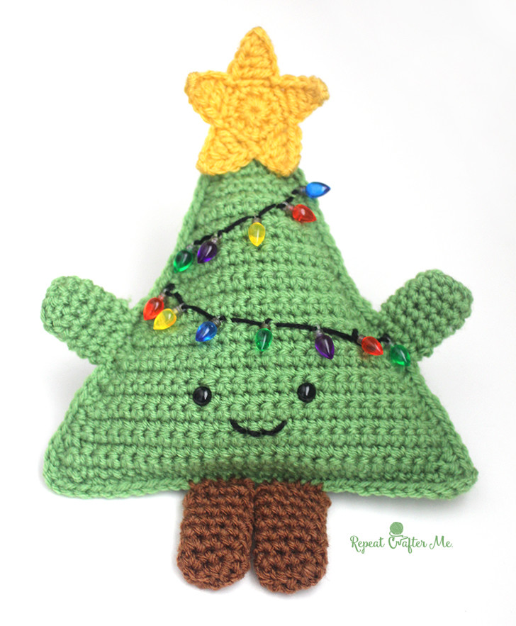 Huggable Crochet Christmas Tree - Fill this holiday season with crochet toy projects that will fill your home with more joy than ever before. #crochettoys #christmastoys #crochetamigurumi