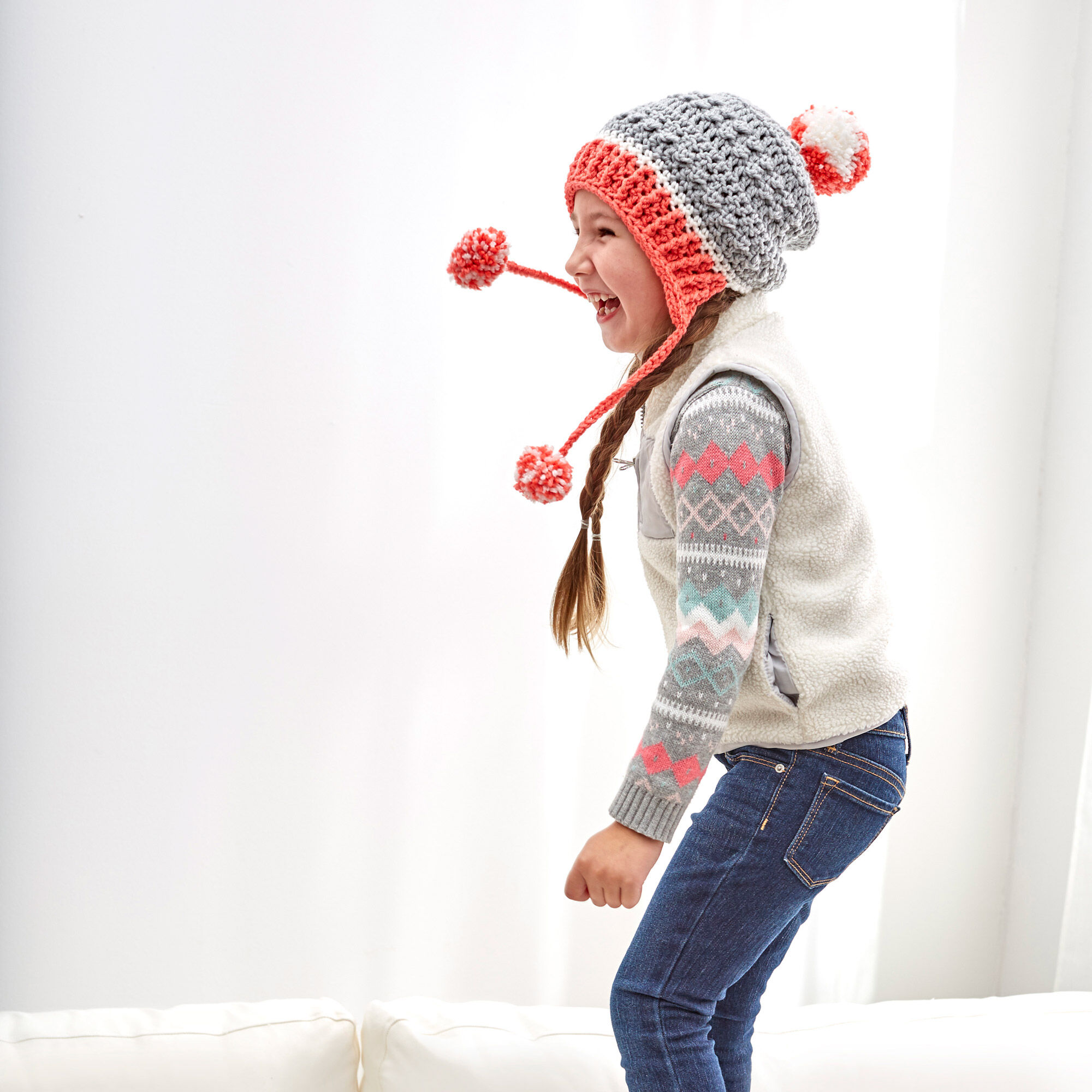 Little Miss PomPom Hat - This list of Christmas Crochet hat patterns will supply you with anything from the classics (Santa, Rudolph, Snowman) to fun animals and well-loved characters. #ChristmasCrochetHatPatterns #CrochetHatPatterns #CrochetPatterns
