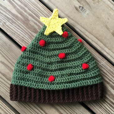 Oh Tannenbaum Christmas Tree Hat - This list of Christmas Crochet hat patterns will supply you with anything from the classics (Santa, Rudolph, Snowman) to fun animals and well-loved characters. #ChristmasCrochetHatPatterns #CrochetHatPatterns #CrochetPatterns