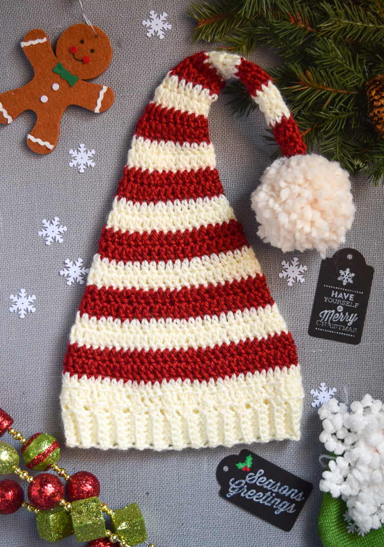 Pixie Elf Striped Newborn Hat - This list of Christmas Crochet hat patterns will supply you with anything from the classics (Santa, Rudolph, Snowman) to fun animals and well-loved characters. #ChristmasCrochetHatPatterns #CrochetHatPatterns #CrochetPatterns