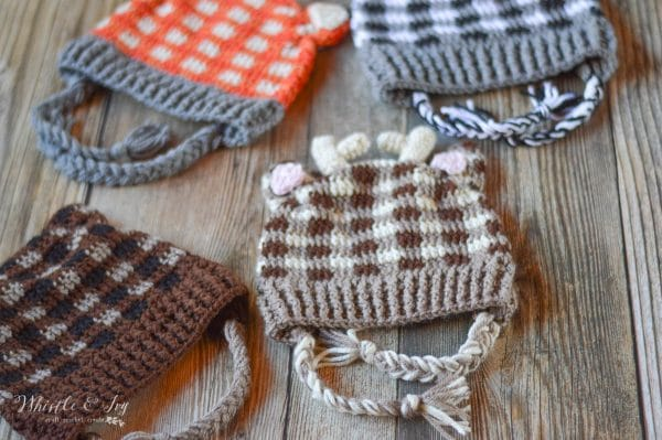 Plaid Crochet Woodland Animal Hats - This list of Christmas Crochet hat patterns will supply you with anything from the classics (Santa, Rudolph, Snowman) to fun animals and well-loved characters. #ChristmasCrochetHatPatterns #CrochetHatPatterns #CrochetPatterns
