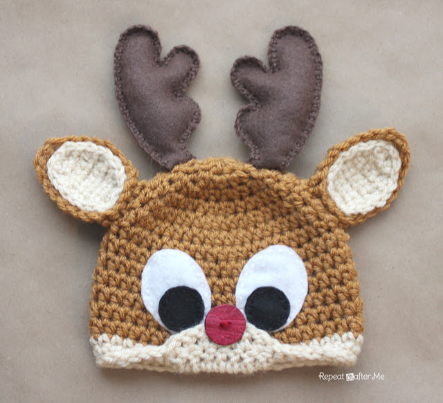 Rudolph The Reindeer Hat - This list of Christmas Crochet hat patterns will supply you with anything from the classics (Santa, Rudolph, Snowman) to fun animals and well-loved characters. #ChristmasCrochetHatPatterns #CrochetHatPatterns #CrochetPatterns