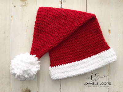 Santa Hat - This list of Christmas Crochet hat patterns will supply you with anything from the classics (Santa, Rudolph, Snowman) to fun animals and well-loved characters. #ChristmasCrochetHatPatterns #CrochetHatPatterns #CrochetPatterns