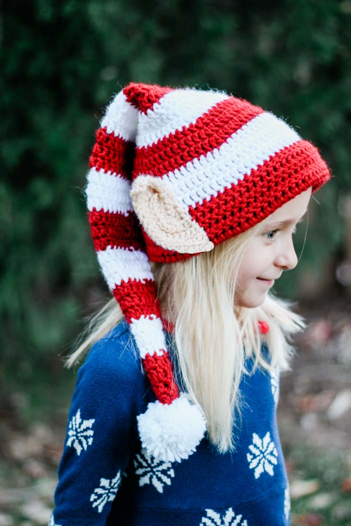 Santa's Helper Elf Hat - This list of Christmas Crochet hat patterns will supply you with anything from the classics (Santa, Rudolph, Snowman) to fun animals and well-loved characters. #ChristmasCrochetHatPatterns #CrochetHatPatterns #CrochetPatterns
