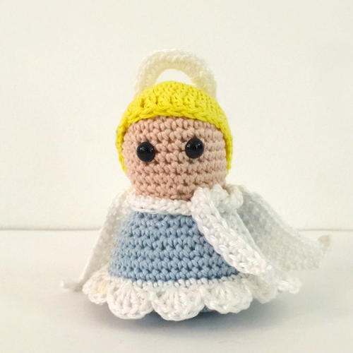 Serene Christmas Angel - Fill this holiday season with crochet toy projects that will fill your home with more joy than ever before. #crochettoys #christmastoys #crochetamigurumi
