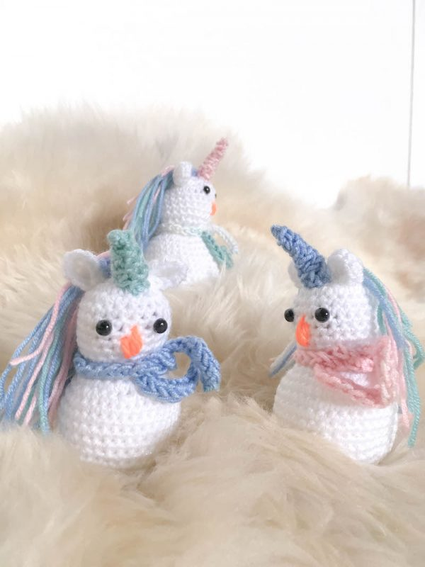 Snowicorn Amigurumi - Fill this holiday season with crochet toy projects that will fill your home with more joy than ever before. #crochettoys #christmastoys #crochetamigurumi