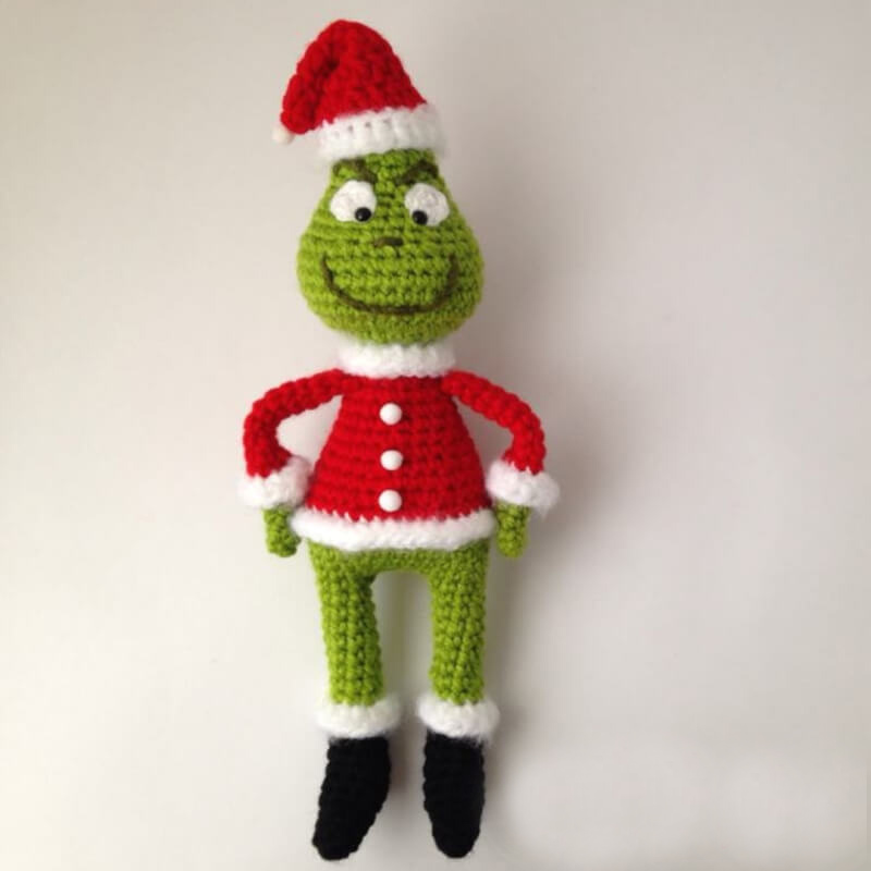 The Grinch Amigurumi - Fill this holiday season with crochet toy projects that will fill your home with more joy than ever before. #crochettoys #christmastoys #crochetamigurumi