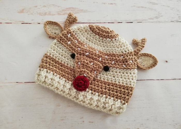 Woodland Spotted Deer Hat - This list of Christmas Crochet hat patterns will supply you with anything from the classics (Santa, Rudolph, Snowman) to fun animals and well-loved characters. #ChristmasCrochetHatPatterns #CrochetHatPatterns #CrochetPatterns