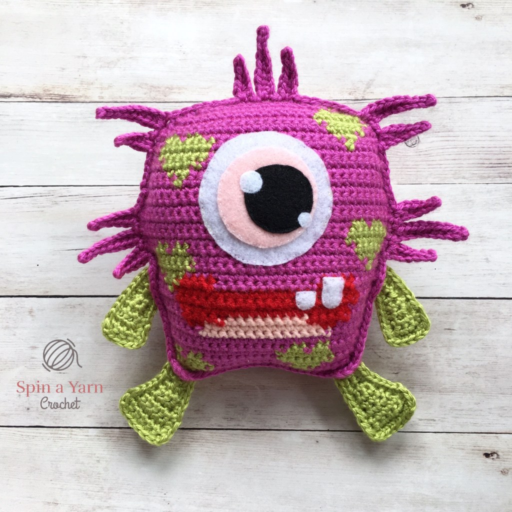 Blinky – Love Monster - One way you can show your love for kids this Valentine's is by crocheting these simple crochet patterns. #simplecrochetpatterns #crochetpatterns #kidscrochetpatterns