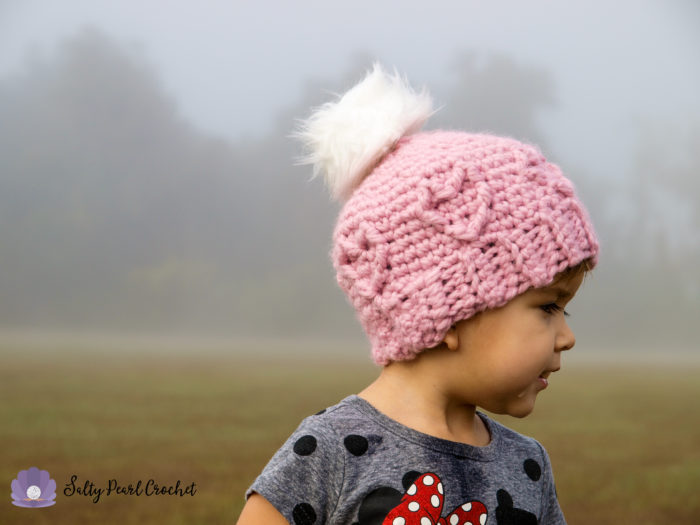 Chunky Cabled Heart Hat - One way you can show your love for kids this Valentine's is by crocheting these simple crochet patterns. #simplecrochetpatterns #crochetpatterns #kidscrochetpatterns