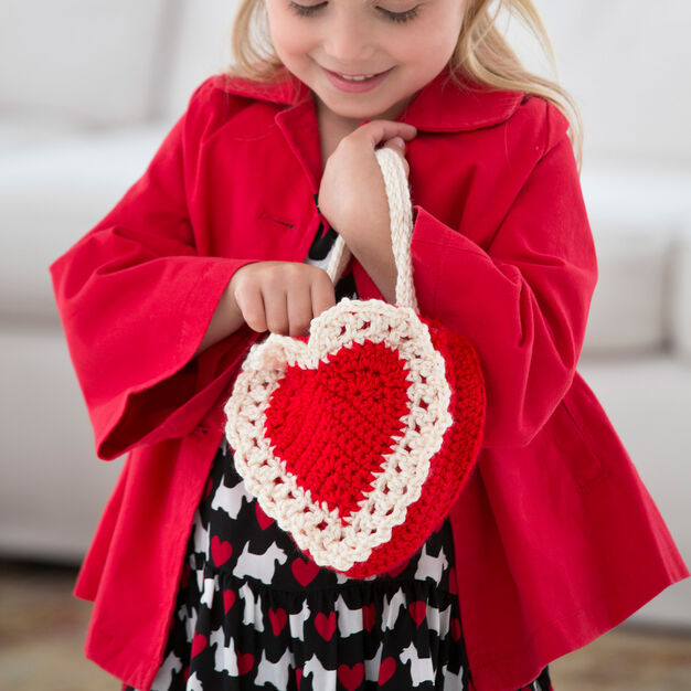 Here's My Heart Gift Bag - One way you can show your love for kids this Valentine's is by crocheting these simple crochet patterns. #simplecrochetpatterns #crochetpatterns #kidscrochetpatterns
