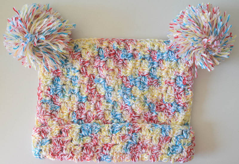 C2C Pom Pom Hat - If you're looking to learn a new crochet skill, check out these 12 corner to corner crochet patterns. #cornertocornercrochetpatterns #C2Ccrochetpatterns #crochetpatterns