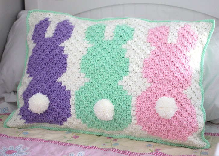 Crochet C2C Bunny Pillow Sham - If you're looking to learn a new crochet skill, check out these 12 corner to corner crochet patterns. #cornertocornercrochetpatterns #C2Ccrochetpatterns #crochetpatterns