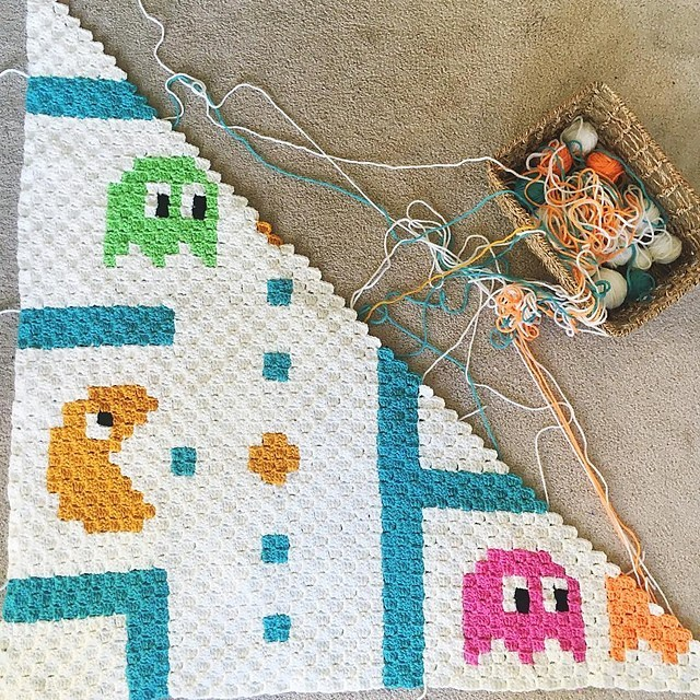 Pacman C2C Baby Blanket - If you're looking to learn a new crochet skill, check out these 12 corner to corner crochet patterns. #cornertocornercrochetpatterns #C2Ccrochetpatterns #crochetpatterns