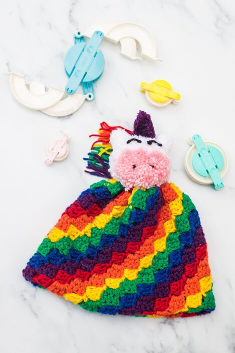 Rainbow C2C Hat - If you're looking to learn a new crochet skill, check out these 12 corner to corner crochet patterns. #cornertocornercrochetpatterns #C2Ccrochetpatterns #crochetpatterns