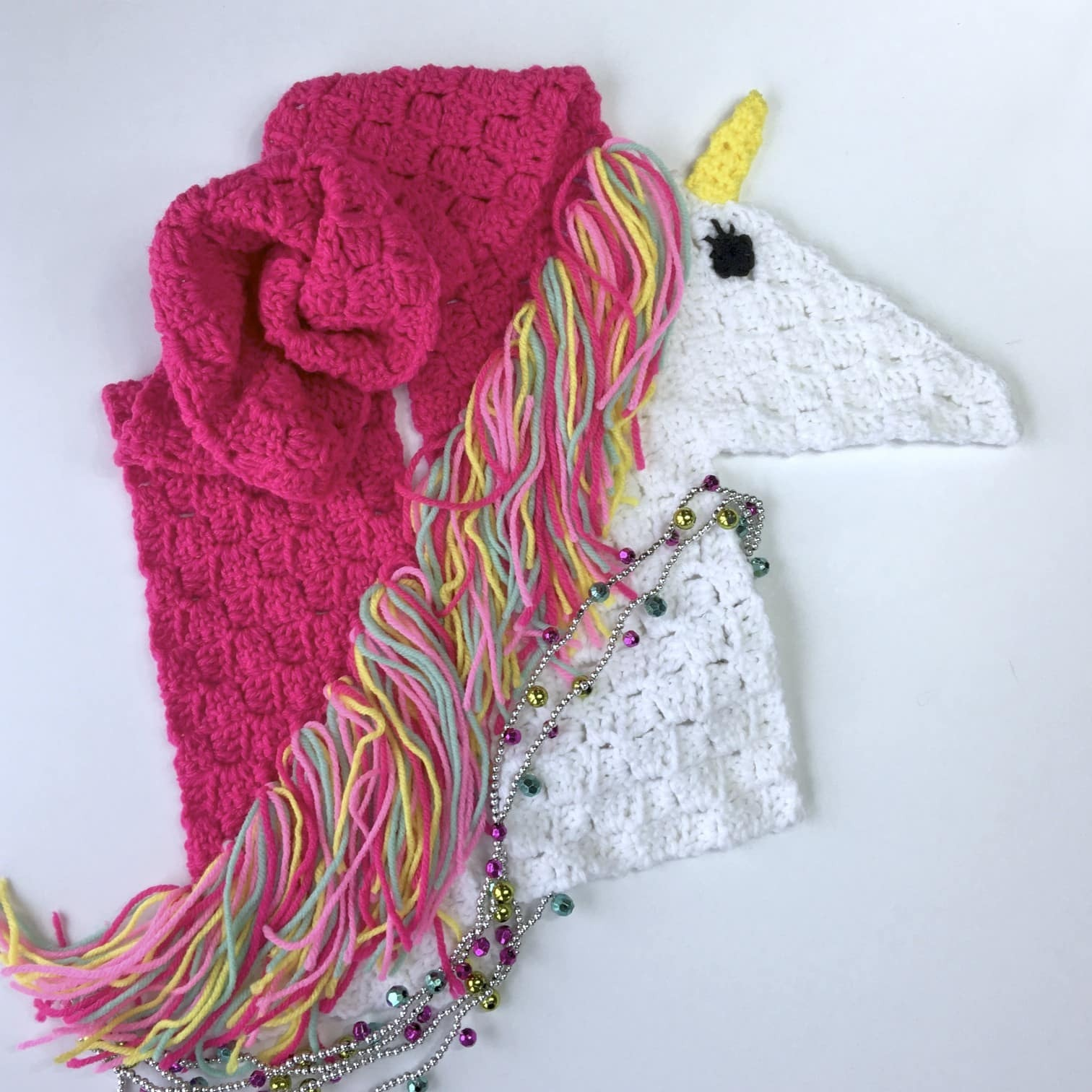 Unicorn Scarf - If you're looking to learn a new crochet skill, check out these 12 corner to corner crochet patterns. #cornertocornercrochetpatterns #C2Ccrochetpatterns #crochetpatterns